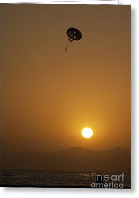 Parasailing At Sunset Greeting Card by Micah May