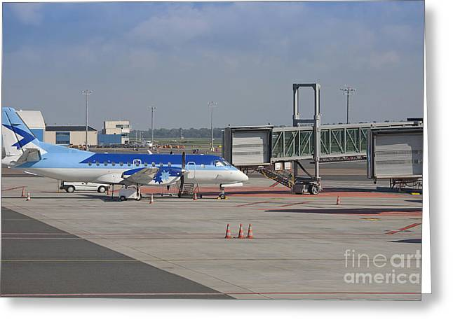 Tallinn Airport Greeting Cards - Parked Airplane at an Airport Gate Greeting Card by Jaak Nilson