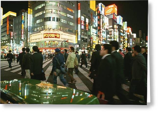 City Lights And Lighting Greeting Cards - Pedestrians Cross A Crowded Tokyo Greeting Card by Justin Guariglia