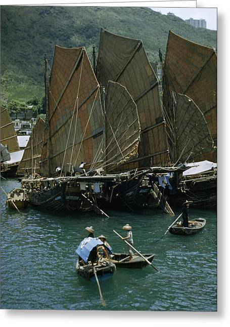 Chinese Ethnicity Greeting Cards - People Pole Small Boats Near Junks Greeting Card by J. Baylor Roberts