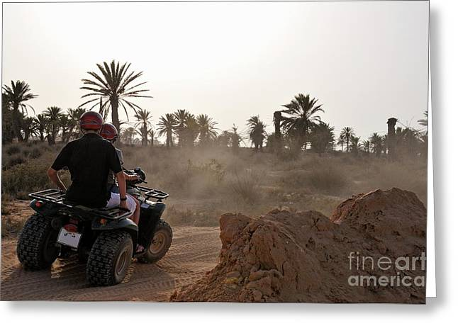 45-49 Years Greeting Cards - People speeding on ATV in desert Greeting Card by Sami Sarkis