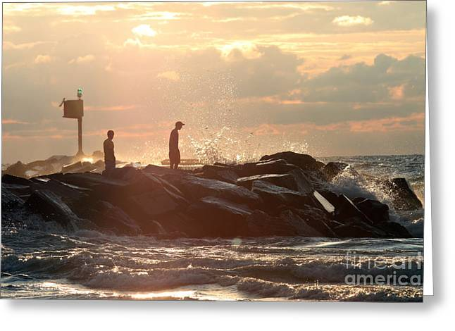 People walking on New Buffalo Michigan breakwater Greeting Card by Christopher Purcell