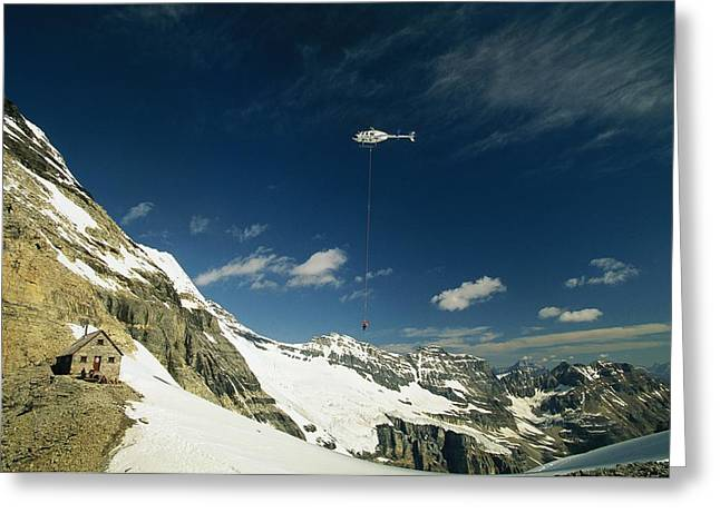 Person Dangles From A Helicopter Greeting Card by Michael Melford