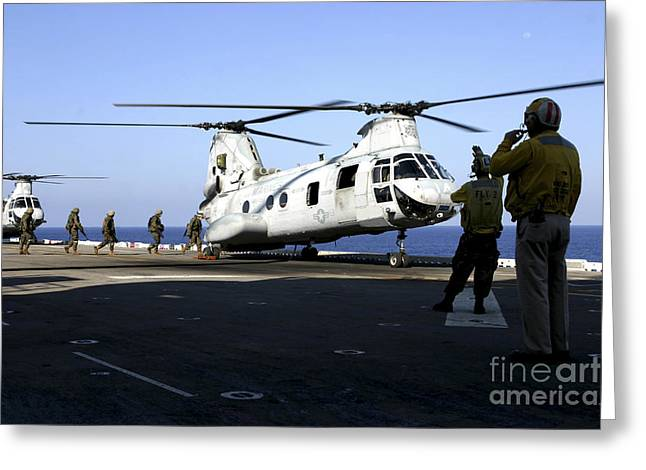 Personnel Walk Into The Rear Greeting Card by Stocktrek Images