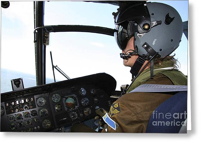 Ch-46 Greeting Cards - Pilot In The Cockpit Of A Ch-46 Sea Greeting Card by Daniel Karlsson