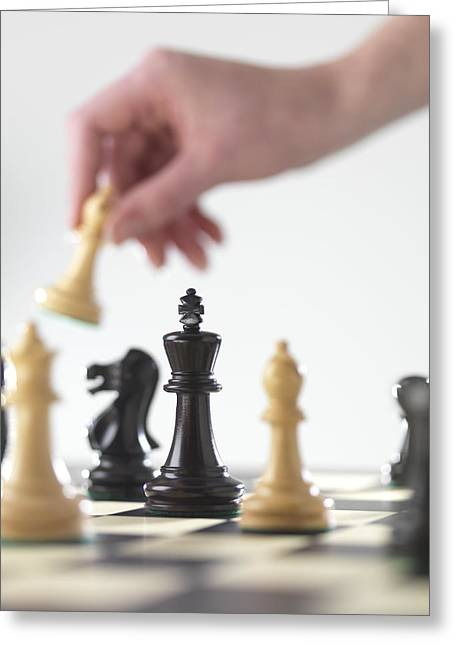 Chess Piece Greeting Cards - Playing Chess Greeting Card by Tek Image