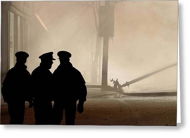 Police Officer Greeting Cards - Police watching firefighters during Moose Jaw New Years Fire Greeting Card by Mark Duffy