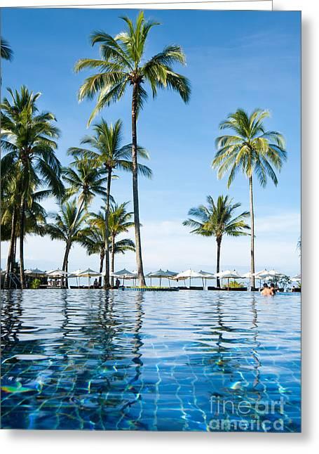 Aqua Condominiums Photographs Greeting Cards - Poolside Greeting Card by Atiketta Sangasaeng