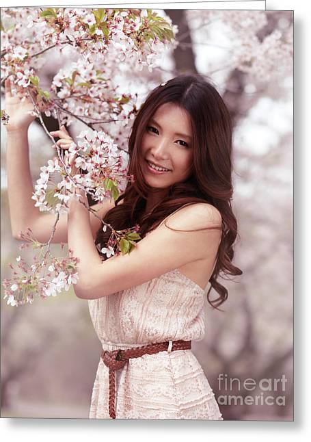 Asian Ethnicity Greeting Cards - Portrait of a Young Smiling Woman Standing at a Cherry Tree Greeting Card by Oleksiy Maksymenko