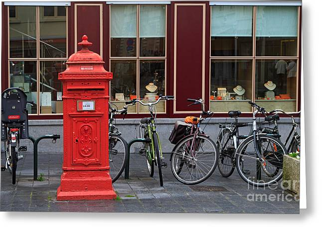 Postbox Greeting Cards - Postbox and Bicycles in Front of the Diamond Museum in Bruges Greeting Card by Louise Heusinkveld