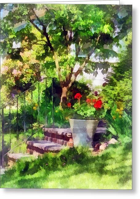 Geranium Greeting Cards - Pot of Geraniums Near Steps Greeting Card by Susan Savad