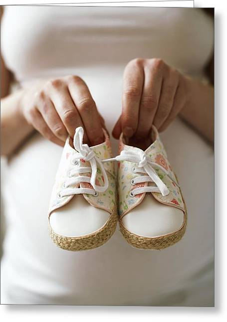 35-39 Years Greeting Cards - Pregnant Woman Holding Baby Shoes Greeting Card by Ian Boddy