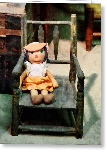 Rag Doll In Chair Greeting Card by Susan Savad
