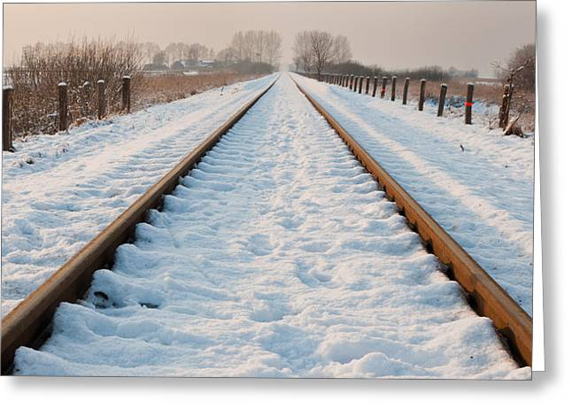 Best Sellers -  - Wooden Platform Greeting Cards - Railway tracks in the snow Greeting Card by Ruud Morijn