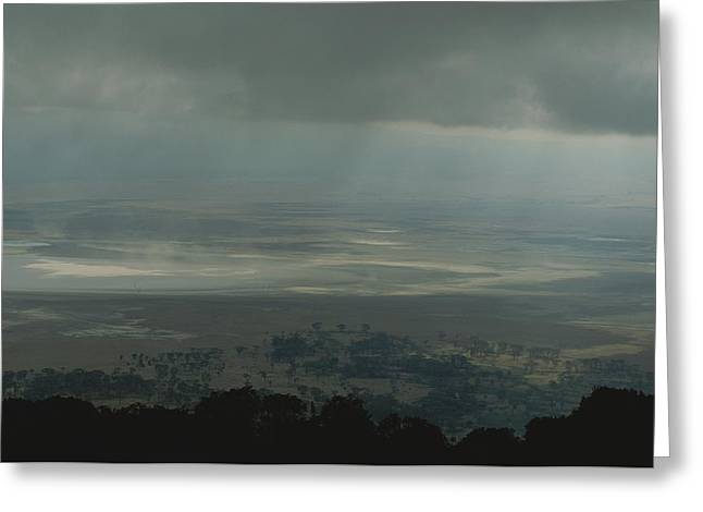 Dry Lake Greeting Cards - Rain Clouds Over The Ngorongoro Crater Greeting Card by Kenneth Garrett