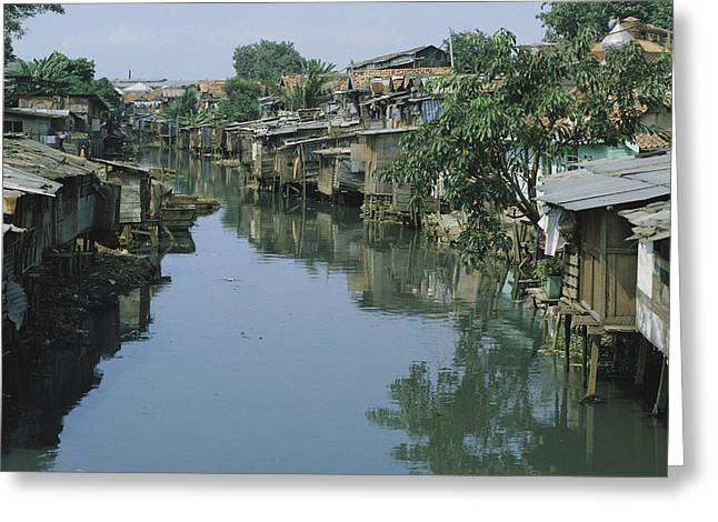 Poor People Greeting Cards - Ramshackle Houses Line A Canal Greeting Card by Tim Laman