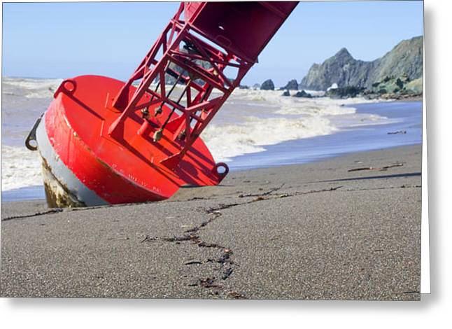 Red bell buoy on beach with bottle Greeting Card by Garry Gay