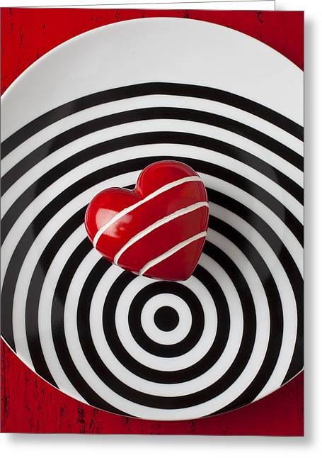 Hard Life Greeting Cards - Red heart on circle plate Greeting Card by Garry Gay