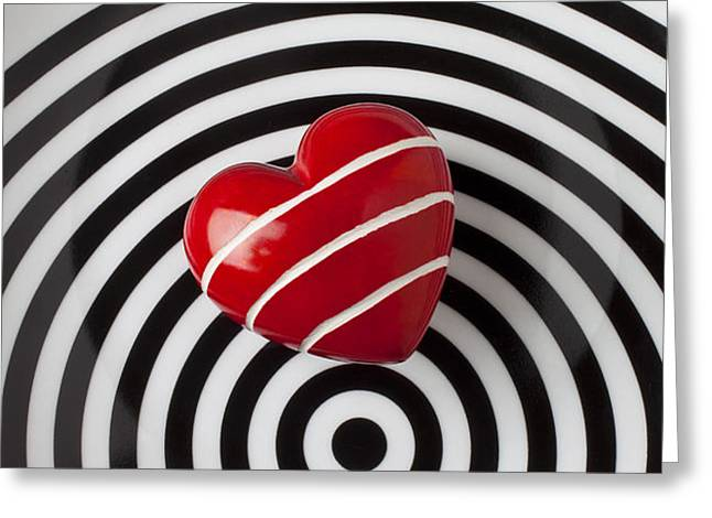 Red heart on circle plate Greeting Card by Garry Gay