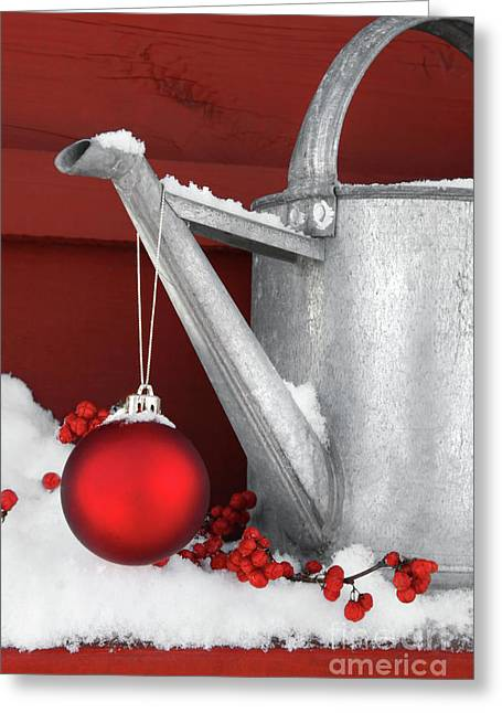 Glass Ball Greeting Cards - Red ornament on watering can Greeting Card by Sandra Cunningham