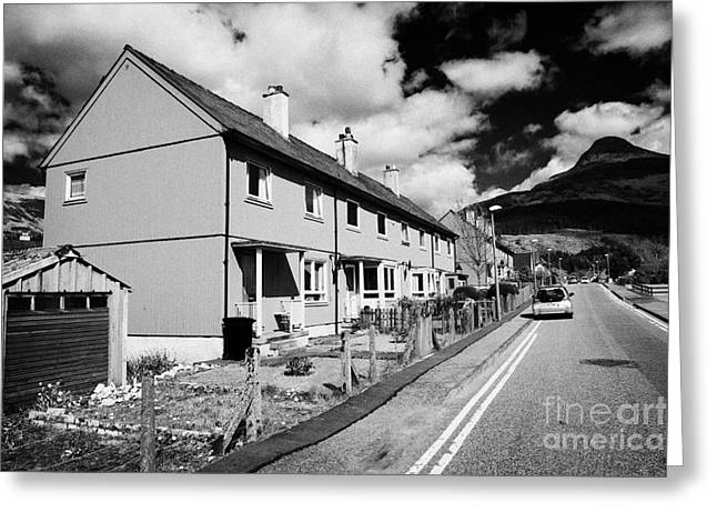 Pap Greeting Cards - Red Painted Wooden Clad Houses On The Main Street In Glencoe Highlands Scotland Uk With The Pap Of G Greeting Card by Joe Fox