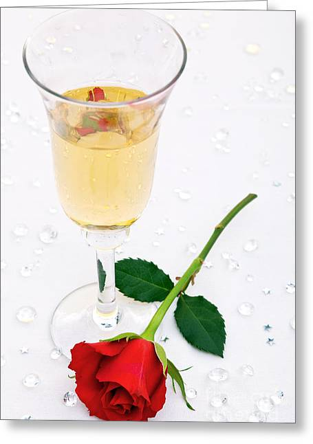 Bubbly Greeting Cards - Red rose and a glass of champagne Greeting Card by Richard Thomas