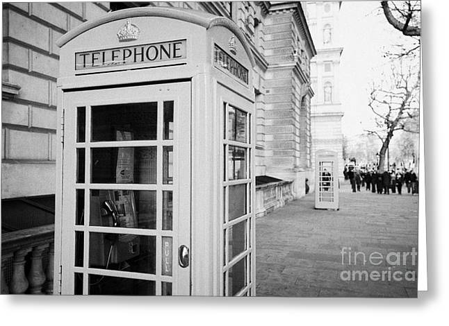 Call Box Greeting Cards - red telephone call boxes on the pavement in whitehall London England UK United kingdom Greeting Card by Joe Fox