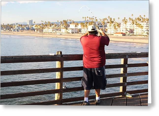 Reeling in a Big One at Oceanside Pier Greeting Card by Jim Vansant