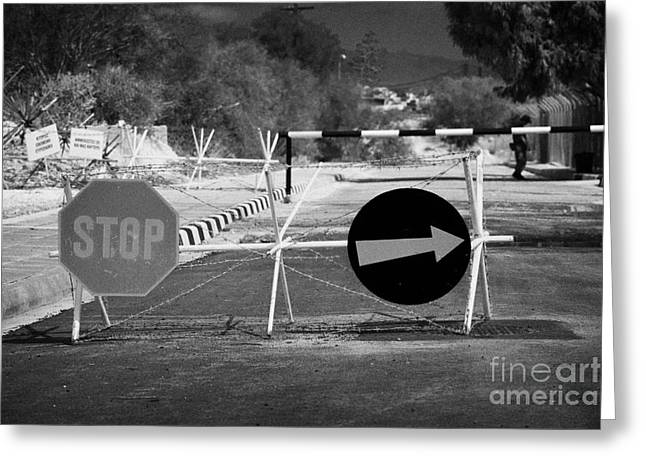 Roadblock Greeting Cards - roadblock at greek cypriot border post at famagusta at the UN buffer zone in the green line Greeting Card by Joe Fox