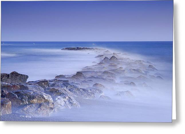 Rocks fighting against the waves Greeting Card by Guido Montanes Castillo