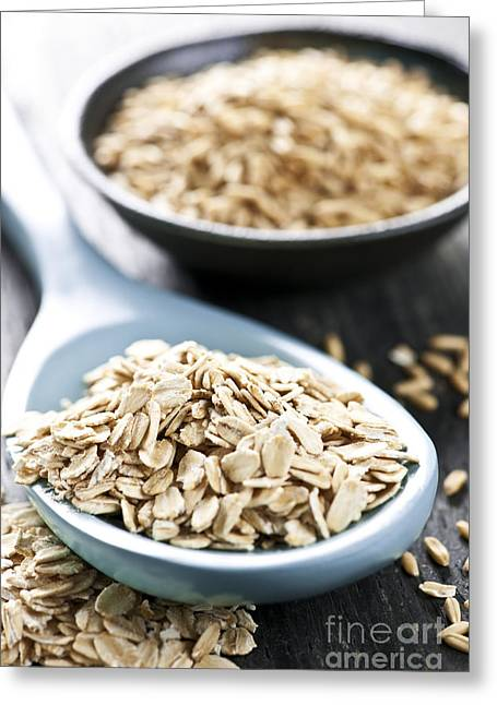 Oatmeal Greeting Cards - Rolled oats and oat groats Greeting Card by Elena Elisseeva