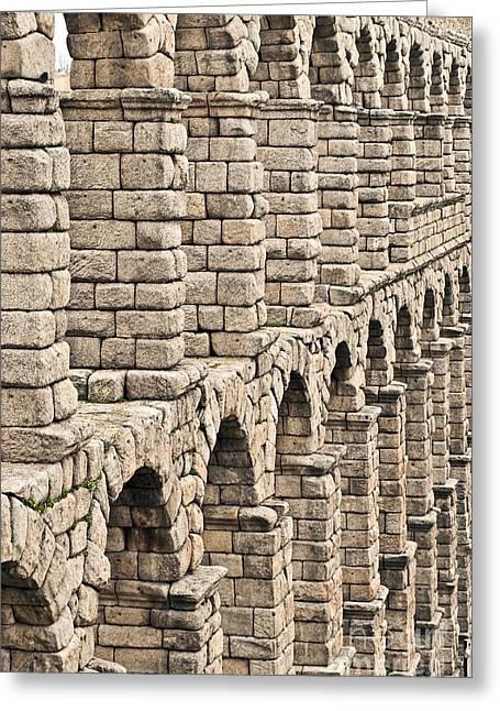 Castilla Greeting Cards - Roman aqueduct Segovia Greeting Card by John Greim