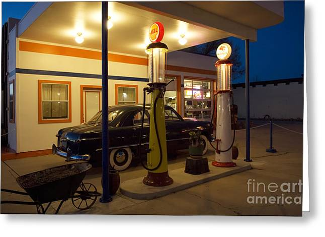 Sights Along Route 66 Greeting Cards - Route 66 Garage At Night Greeting Card by Bob Christopher