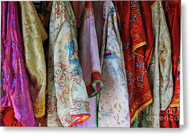 No Clothing Greeting Cards - Row of hanged traditionnal vietnamese clothes Greeting Card by Sami Sarkis