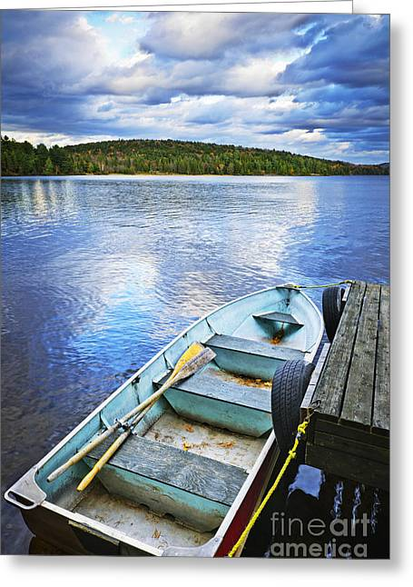 Autumn Landscape Photographs Greeting Cards - Rowboat docked on lake Greeting Card by Elena Elisseeva