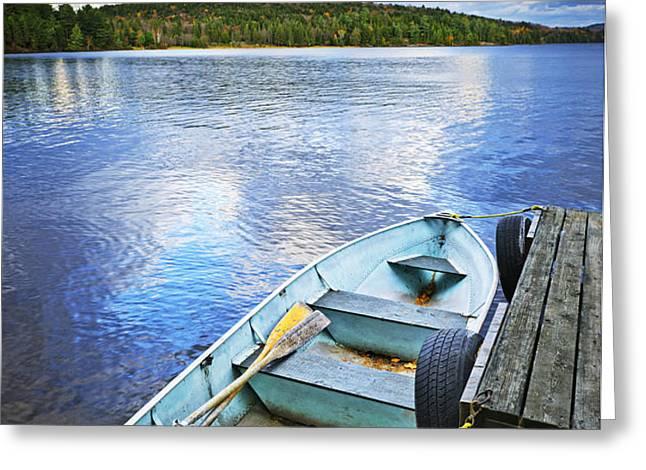 Rowboat docked on lake Greeting Card by Elena Elisseeva