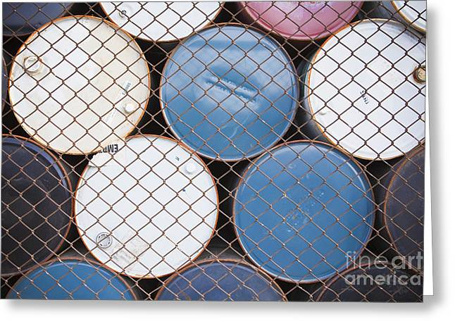 Rows of Stacked Barrels Behind a Fence Greeting Card by Paul Edmondson