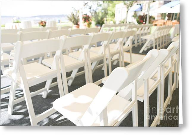 Rows Of White Folding Chairs Greeting Card by Ned Frisk