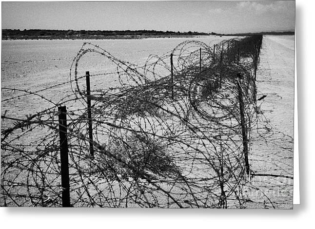 Sovereign Greeting Cards - rusty barbed wire fence on the akrotiri salt flats the limit of the western Sovereign Base Area Greeting Card by Joe Fox