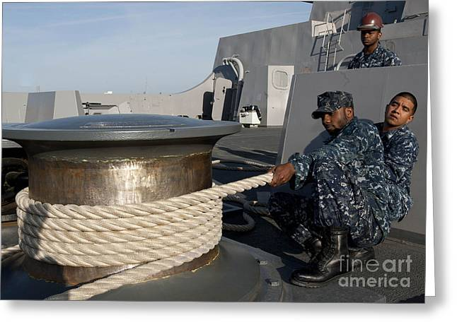 Uss North Carolina Greeting Cards - Sailors Handle Mooring Lines Aboard Uss Greeting Card by Stocktrek Images