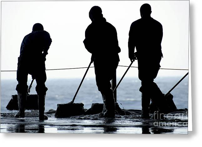 Scrubbing Greeting Cards - Sailors Sweep Out The Hangar Bay Aboard Greeting Card by Stocktrek Images