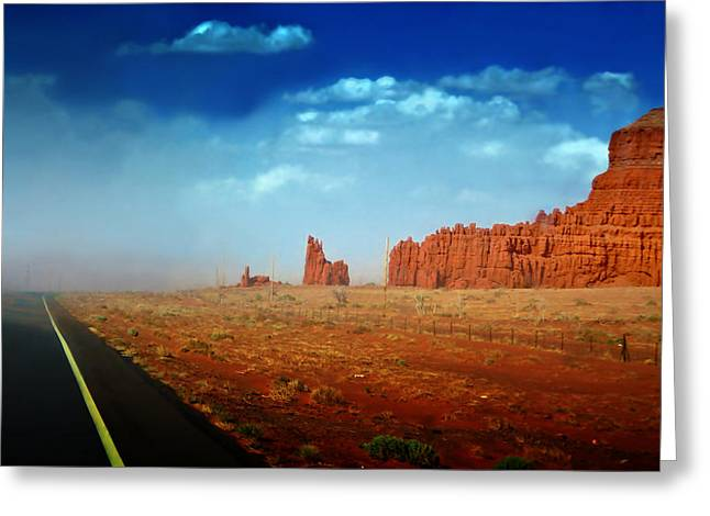 Sandstorm Greeting Cards - Sandstorm moving in to Monument Valley Greeting Card by Ellen Heaverlo