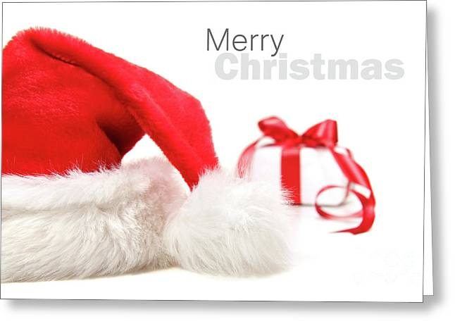 Santa hat and gift with red bow Greeting Card by Sandra Cunningham