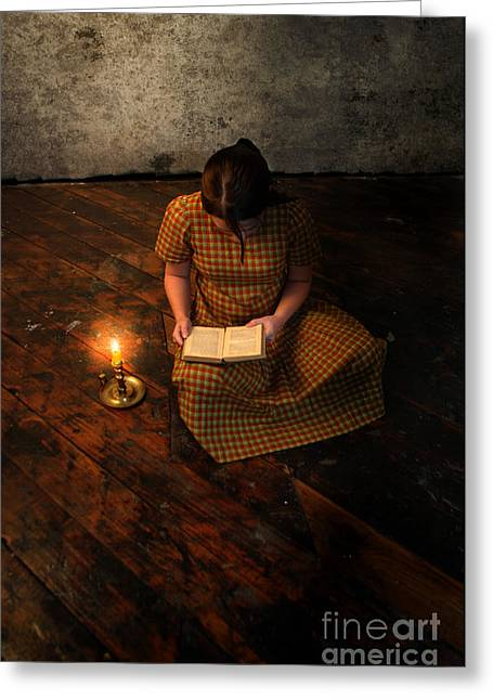 Plaid Dress Greeting Cards - Schoolgirl Sitting on Wood Floor Reading by Candlelight Greeting Card by Jill Battaglia