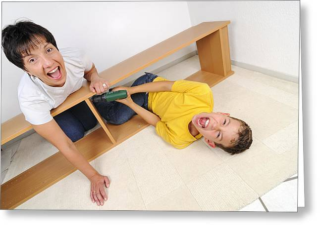 Devilish Greeting Cards - Screaming mother and son assembling furniture Greeting Card by Matthias Hauser