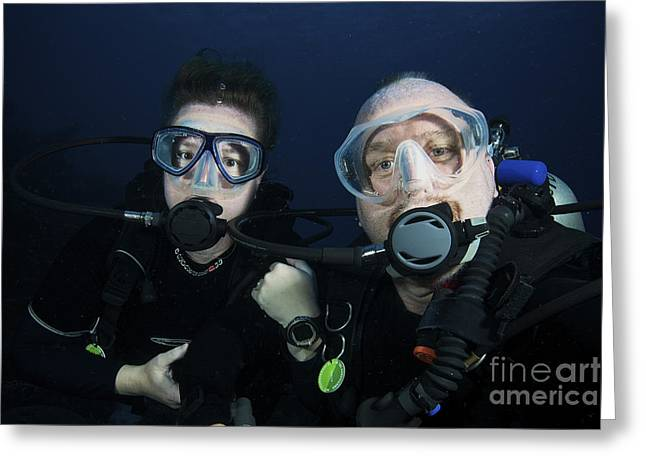 Scuba Diving Greeting Cards - Scuba Divers Pose For The Camera Greeting Card by Terry Moore