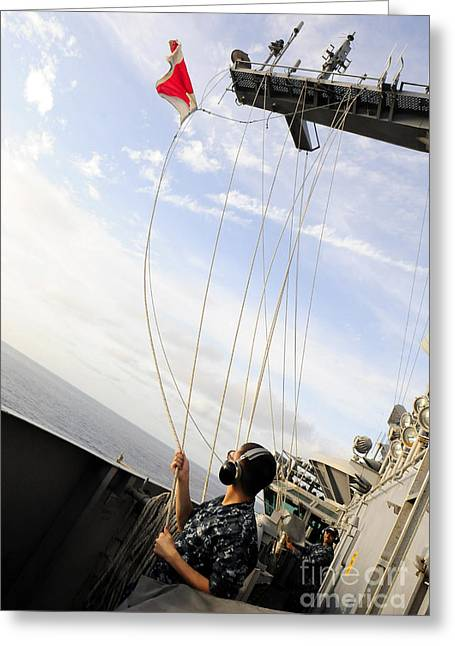 Flight Operations Photographs Greeting Cards - Seaman Raises The Foxtrot Flag Greeting Card by Stocktrek Images
