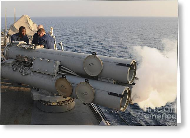 Guided Missiles Greeting Cards - Seamen Fire An Air Slug From A Mk-32 Greeting Card by Stocktrek Images
