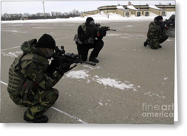 Street Machine Greeting Cards - Security Forces Members Endure Greeting Card by Stocktrek Images