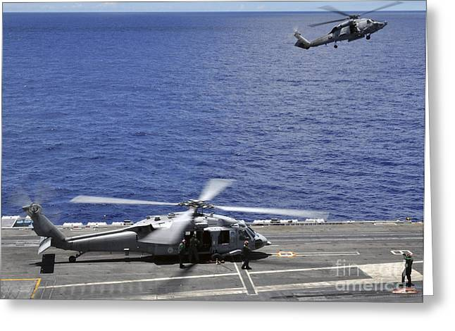 Supercarrier Greeting Cards - Sh-60 Sea Hawk Helicopters Land Aboard Greeting Card by Stocktrek Images